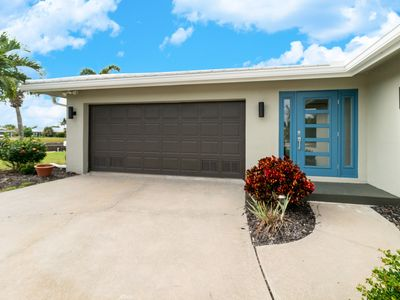 Photo for NEW TO VRBO! PG Oasis!  Private Dock & Heated Pool, 3BD, 2BT, 2CG UPDATED HOUSE