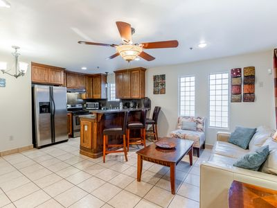 Photo for NEW LISTING! Lovely townhome w/ shared pool & enclosed yard - close to the beach