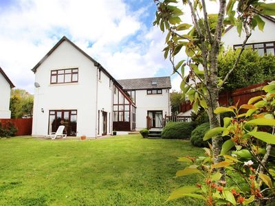 Photo for A detached, 4-bedroom architect-designed family house in the heart of Llangennith village surrounded