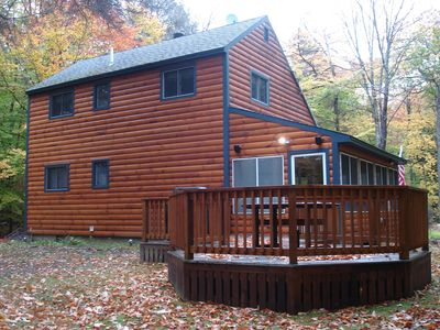 rear of the house with deck and grill