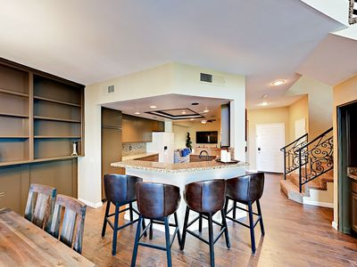 Kitchen - Perch at the breakfast bar with seating for 4.