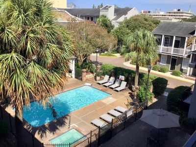 Photo for NoLa Getaway Starts Here! Comfy King Unit, Pool, Hot Tub, Walk to Attractions