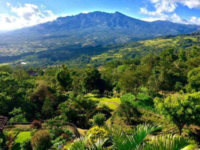 Photo for Humming bird Cottage above rainforest, stunning volcano view, beautiful gardens