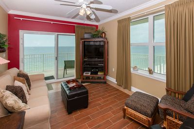 Living room with wood tile floors, Gulf-front patio