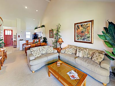Living Area - Relax in the bright Great Room, furnished with a plush sofa and love seat.