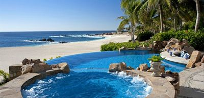 Beachfront luxury-- feel the waves crash from our backyardpatio and pool