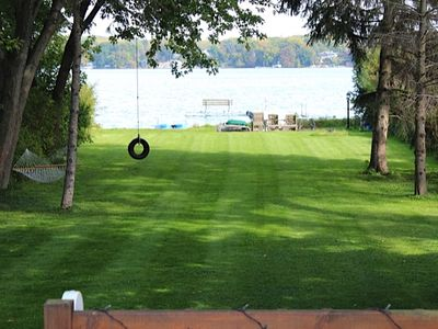 Photo for Large lakefront home, huge lawn, private pier, sandy beach