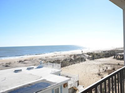 Photo for Cozy, comfortable 2 bedroom oceanfront condo with free WiFi, lots of space, and a fabulous view of the ocean located in quiet midtown and mere steps from the beach!