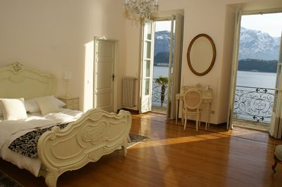 Our beautiful master bedroom with balcony & views across the lake to Bellagio