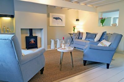 Living-room: comfy for 4 with a deep sofa, 2 armchairs and lots of cushions
