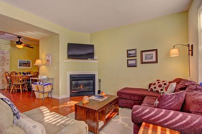 Kingdom Park Retreat - a SkyRun Breckenridge Property - Charming living room with gas fireplace and TV