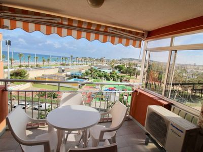 Photo for Sea view terrace 100m from La Pineda beach and at the foot of aquopolis