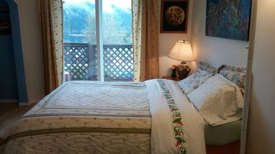 Cozy queen memory foam bed with bright atmosphere and inlet views.