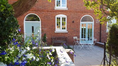 Photo for A delightful mews cottage within the private grounds of Breedon Hall