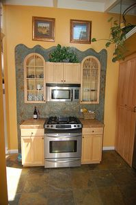 kitchen with stove, microwave