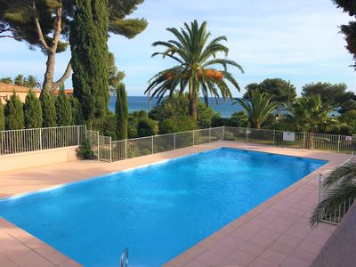 Photo for 4 bed sleeps 8  beach front villa with Shared Pool and Private Garden.