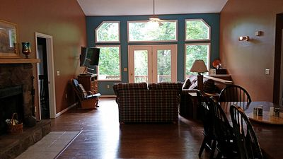 Open family room overlooking mountains, ski slopes. golf course & babbling brook