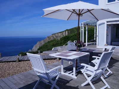 Photo for Superb house and panoramic views,overlooking the sea. Devon surfing coast.