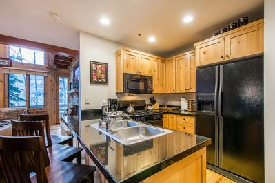 A kitchen with a full suite of appliance and implements lets you cook full meals