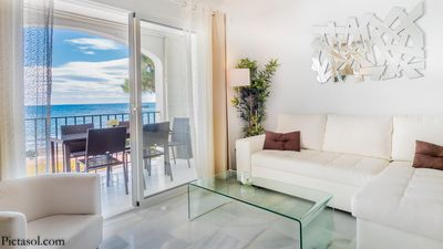 Photo for Dona Lola Micaela  Beach front duplex apartment with open sea and beach views located between Marbella and Fuengirola CS148