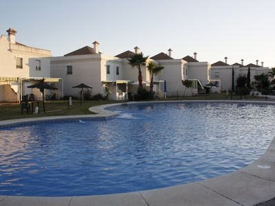 Photo for Beautiful beach house with pool and adjacent golf course
