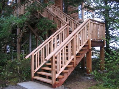 The stairs leading up from the driveway.