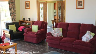 Comfortable seating with double patio doors to secure front lawn