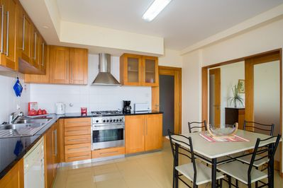 Kitchen and pantry with washing machine and dishwasher, fridge and microwave