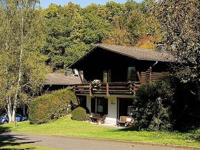 Photo for Tidy chalet with fireplace, located in wooded area