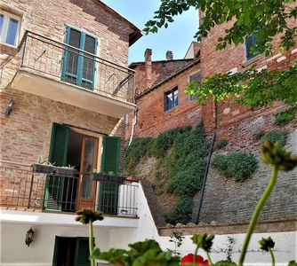 Photo for Private Villa with WIFI, hot tub, patio, pets allowed, panoramic view, close to Montepulciano