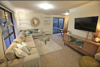 Generous living room - huge couch, games in cupboard, Table overlooks front yard