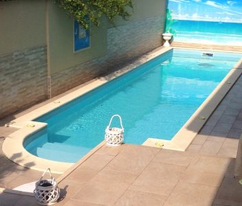 Photo for Villa Le Tre Palme ... Suite in relax ... immersed in the green garden with swimming pool