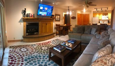 Living room with gas fireplace and Smart TV