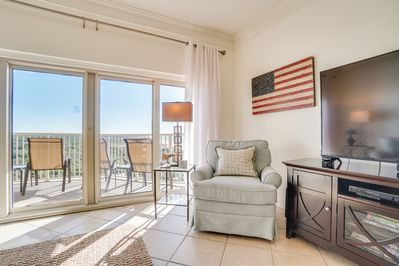 Beach Manor 1206 - Living Room - The living room reveals spectacular views of the gorgeous beach awaiting you.