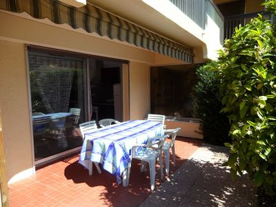 Photo for LAVANDOU - Large 2 ROOMS cabin in ground garden. Beautiful terrace. TO HAVE.