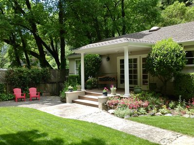 Peaceful, canyon and creek side setting. Comfortable front garden and entry.
