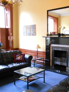 Drawing room with black marble fireplace.