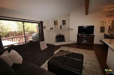 Living Room Featuring Fireplace and Smart TV