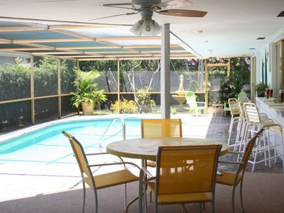 Photo for SCREENED HEATED POOL, WALK TO  BEACH