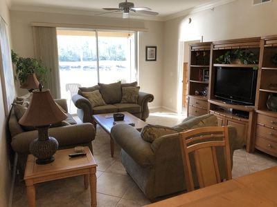 Comfortable and spacious main room with high ceilings and pristine sunset views