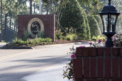 Main entrance to Pinehurst #6 off of 15/501. Our home is   about 2 miles in.