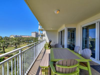 Photo for Lush private balcony home, steps away from the beach w/shared pool