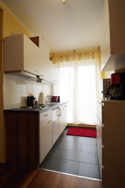 Apartment 2447 Is Equipped With A Flat Screen Tv There Also Kitchen