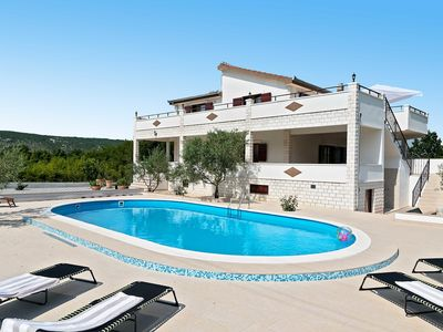 Photo for This 4-bedroom villa for up to 10 guests is located in Trogir and has a private swimming pool, air-c
