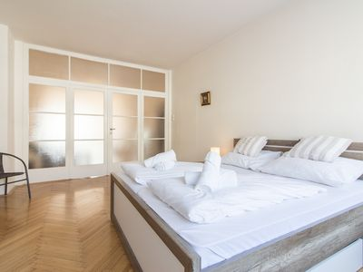Photo for Large Apartment 1min Walk to Metro Andel by easyBNB