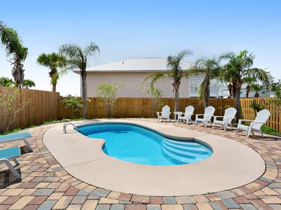 Photo for Coastal getaway w/ a private pool, furnished patio, gas grill, & enclosed yard