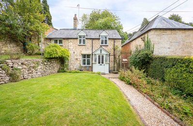 Photo for Rose Tree Cottage is a listed, detached Cotswold stone cottage, sitting on a hill near Stroud
