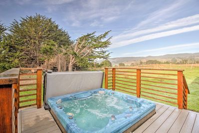 Spend evenings under the stars in your private hot tub.