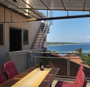 Photo for Three bedroom apartment with terrace and sea view Supetarska Draga - Gonar, Rab (A-4987-b)