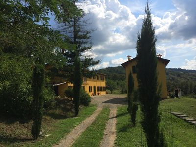 Great approach to the villa through cypress trees.